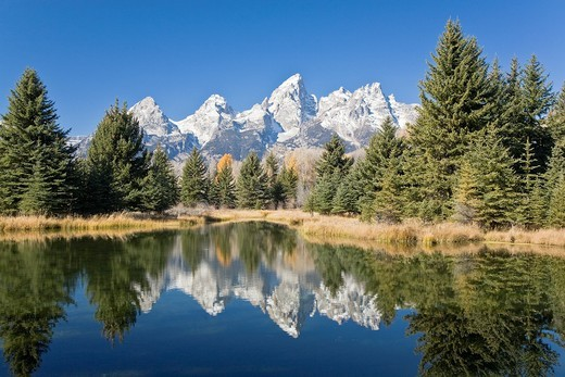 Stock Photo: 1566-633502 Reflected light on water from the Grand Teton Mountain Range, outside of Jackson Hole, Wyoming  This image was shot from the Schabawacker Landing on the snake river