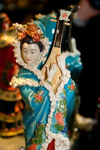 Painted jade carving of a Chinese woman playing a musical instrument, Beijing, China : Stock Photo