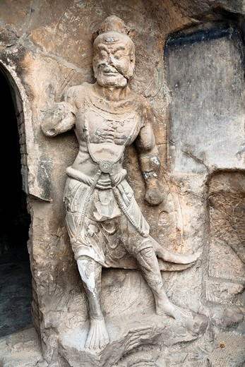 Stock Photo: 1566-637585 A carved stone statue, carved from the rock, Longmen Grottoes and Caves, Luoyang, Henan Province, China