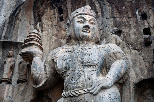 Buddhist carved statue, Fengxian Temple, Longmen Grottoes and Caves, Luoyang, Henan Province, China  Tang Dynasty : Stock Photo