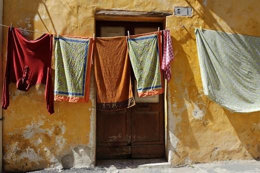 Stock Photo: 1566-641376 Laundry hanging on clothesline, Gallipoli, Puglia, Italy