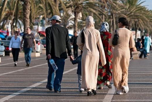 Moroccan family walking on beachside promenade, Agadir, Morocco : Stock Photo