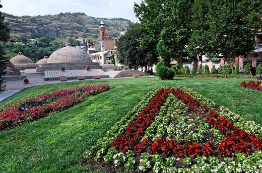 Gardens in front of the domes of Abanotubani, the sulphur baths, Old Town, Tbilisi, Georgia : Stock Photo