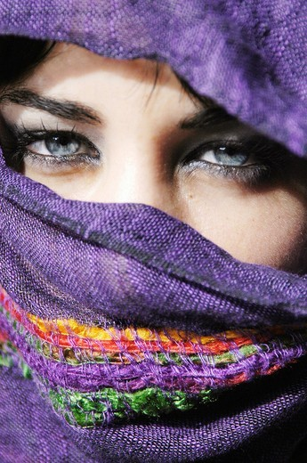 Stock Photo: 1566-643629 Attractive young woman with clear blue eyes with her face covered