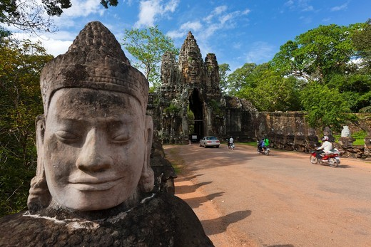 Stone sculptures border the bridge to the temple Angkor Thom in Angkor  Cambodia  Asia : Stock Photo