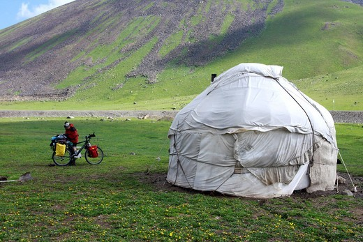 Stock Photo: 1566-644911 Those Kirghiz people who lead a nomadic lifestyle live in a yurt - the round, felt-covered tent that has been the traditional dwelling throughout central Asia for centuries