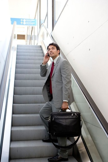 Stock Photo: 1566-650330 Businessman with mobile phone. Delicias station, Zaragoza, Aragón. Spain.