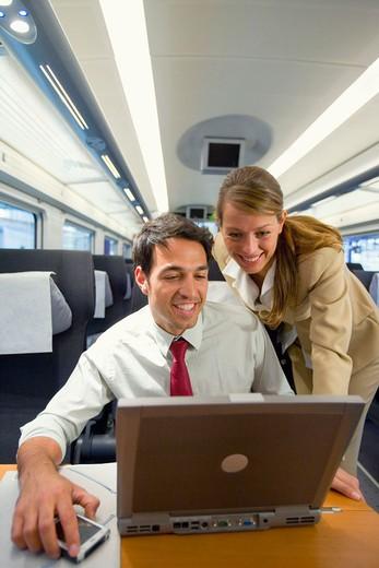 Businessmen working connected to the internet. Passenger. AVE, Tren de Alta Velocidad, Zaragoza, Aragón. Spain. : Stock Photo