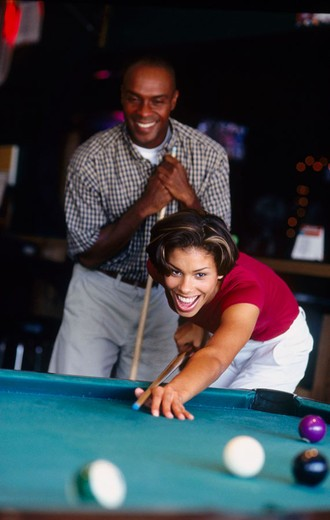 Stock Photo: 1566-672716 couple shooting pool