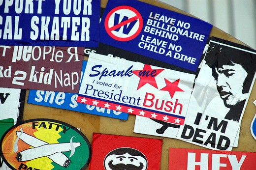 Wild bumper stickers plastered together make comments on contemporary life : Stock Photo