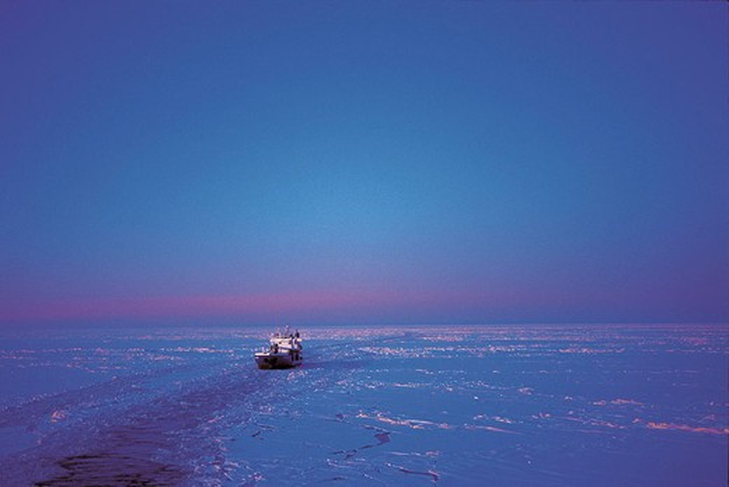 Stock Photo: 1566-673621 Shipping cargo ship, ice, sea, night, blue, cold. Sweden
