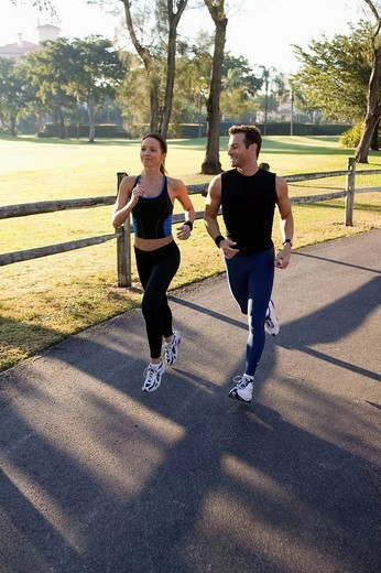 Man an woman jogging down a path : Stock Photo