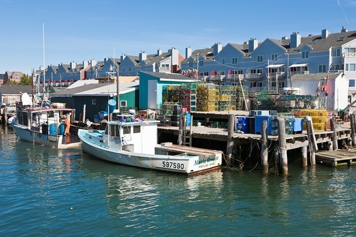 Commercial lobster fishing boats tied to pier in Portland, Maine : Stock Photo