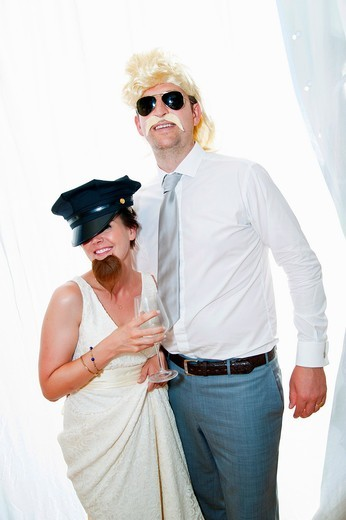 Bride and groom wearing funny disguises : Stock Photo