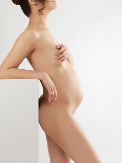Stock Photo: 1566-685315 Artistic photo of a beautiful pregnant young woman naked body profile