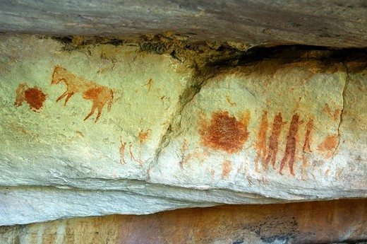 Prehistoric rock paintings of animals and a groupe of peersons by the San people along the Sevilla Rock Art Trail near Clanwilliam, Cederberg Mountains, Western Cape Province, South Africa : Stock Photo