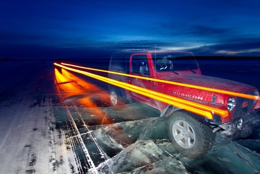Stock Photo: 1566-687104 Long exposure camera times of a Jeep on the ice road from Tibbitt to Contwoyto beginning just outside of Yellowknife, Northwest Territories, Canada  MORE INFO This seasonal ice road is built through the lakes and ponds of the boreal forest in winter to al