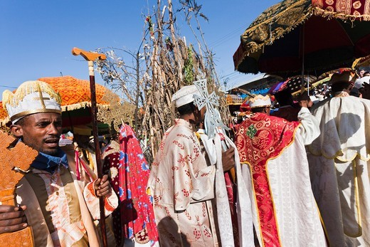 Stock Photo: 1566-687614 Meskel Cerimony in Lalibela Meskal, Meskal, Maskal, Mescel, Mesquel, which is taking place every September  For Meskel many pilgrims are coming to lalibela, to celebrate it at one of the holy palces in Ethiopia  Procession of the clergy around the pile of