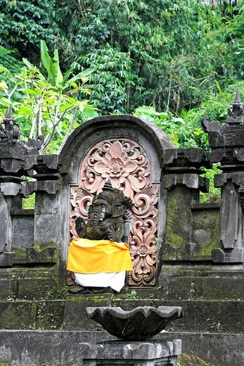 A statue of Ganesha, or Ganesh, at Pura Gunung Kawi Sebatu Temple, Tegallelang  Near Ubud  Bali, Indonesia  This temple should not be confused with the royal monuments in Tampaksiring also called Gunung Kawi : Stock Photo