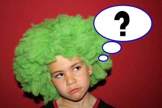 7 year old boy thinking : Stock Photo