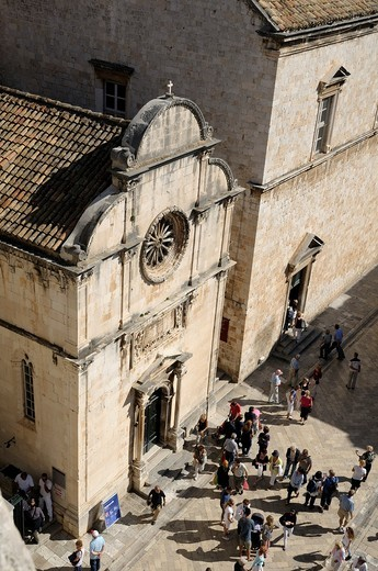 Croatia, Dubrovnik  Pedestrians in front of church of Saint Saviour in old town, seen from city wall : Stock Photo