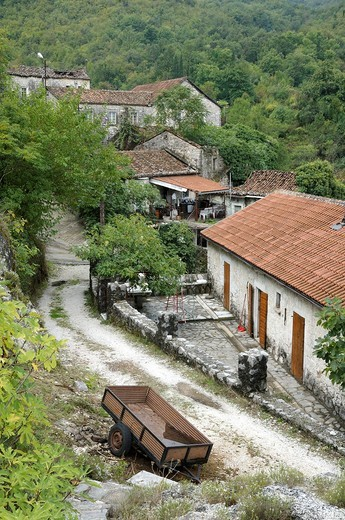 Stock Photo: 1566-690499 Montenegro, Godinje  Village in the mountains above Lake Skadar with typical ancient stone houses set