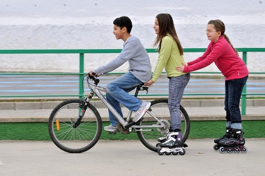 Group of children with bicycle : Stock Photo