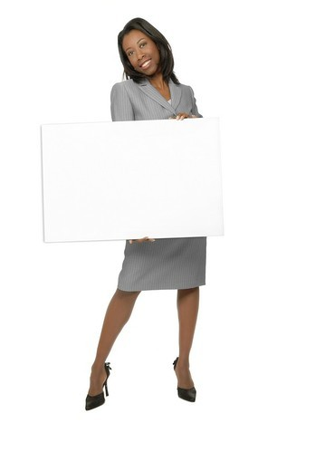Attractive woman of African ethnicity, holding a blank sign or whiteboard : Stock Photo