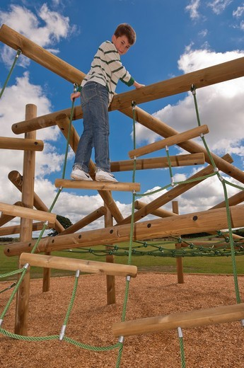 Stock Photo: 1566-691308 A MODEL RELEASED picture of an eleven year old boy on a climbing frame in the Uk