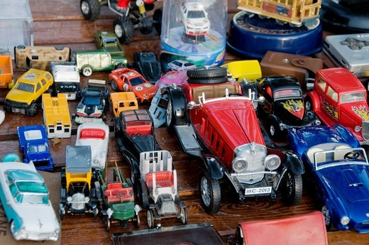 Stock Photo: 1566-692380 Paris, France - Shopping, Outside, Public Flea Market, Children´s Toys, Old Toy Cars, on Display