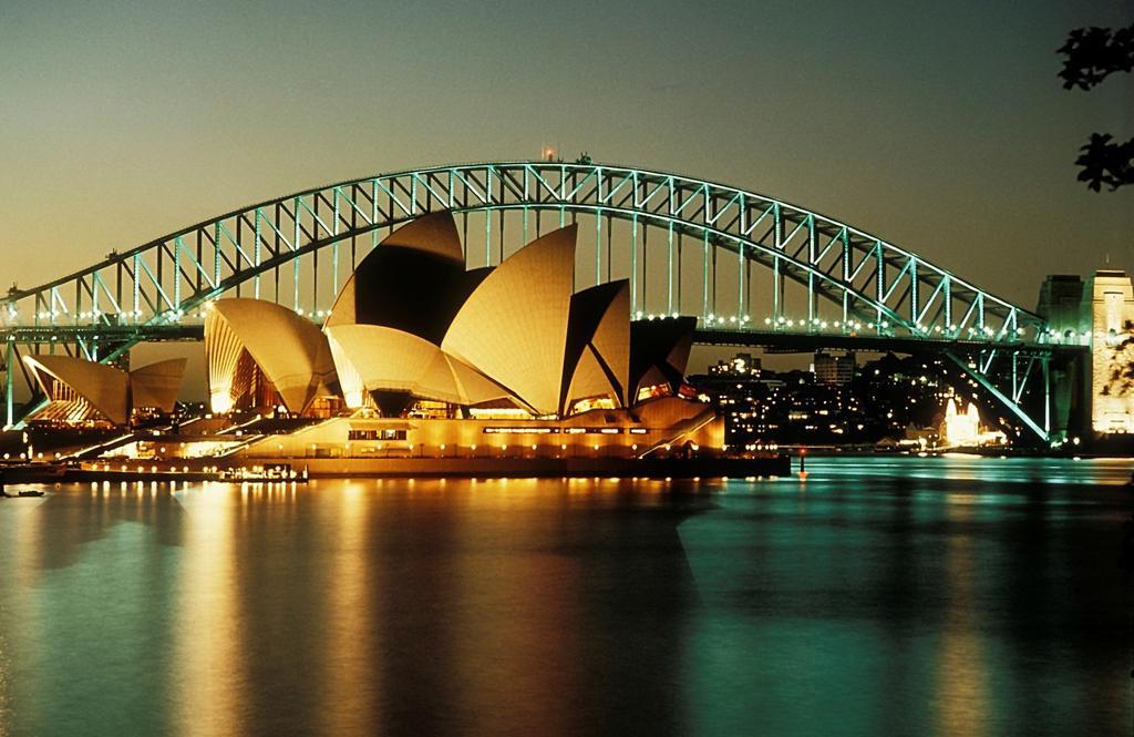 Stock Photo: 1566-692533 Sydney opera house and bridge at night
