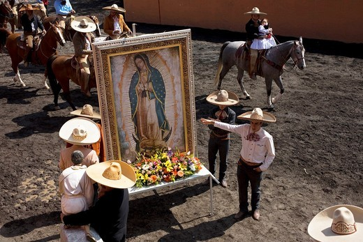 Charros carry an image of the Our Lady of Guadalupe during a rodeo competition in Mexico City, November 16, 2008 : Stock Photo