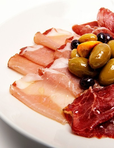 Plate of Cured Meats and Olives : Stock Photo