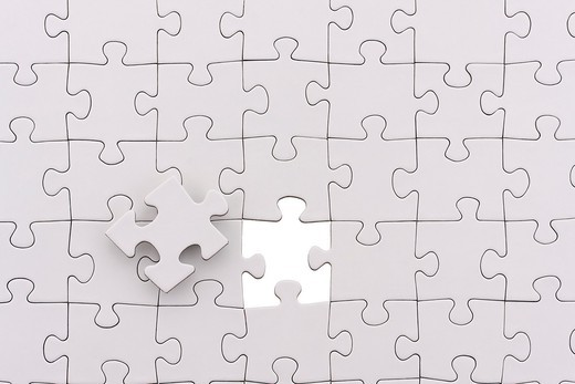 parts of jigsaw - symbolism for existential orientation resp  education : Stock Photo