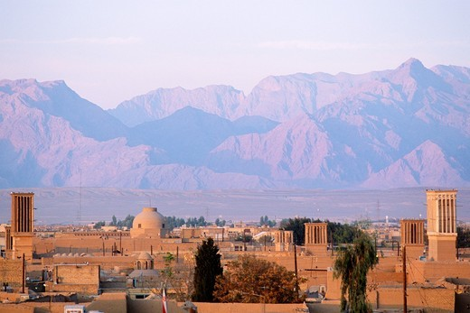 Stock Photo: 1566-695349 Iran, Yazd, old town skyline, mountains,
