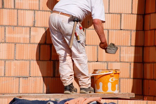 Brick layer , building site , switzerland : Stock Photo