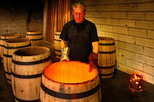 Stock Photo: 1566-700038 France-Lot et Garonne- Master Cooper toasting barrels at the Cooperage Francis M at Marmande