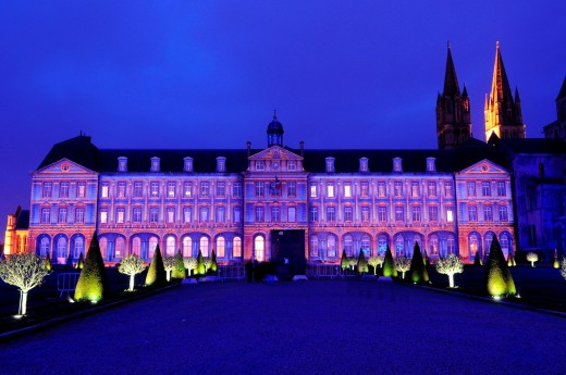 Light show, immense projections of images on the walls of the town hall, Abbaye aux Hommes, Men´s Abbey, Caen, Calvados, Normandy, France, December 2010  Lighting designer: Benoît Quero/Spectaculaires. : Stock Photo