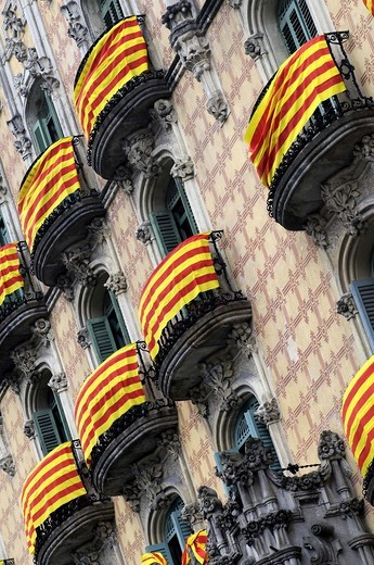 Catalonia Flags on balconies. St. George´s Day, Catalan holiday. Ramos Houses. 1906. 30-32, Lesseps square. Architect Jaume Torres i Grau. Barcelona. Catalonia. Spain. : Stock Photo