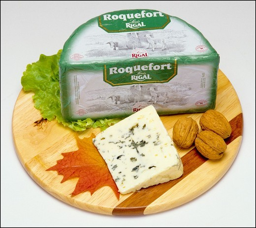 Stock Photo: 1566-702056 Whole Roquefort French blue cheese and wedge with nuts on wooden board