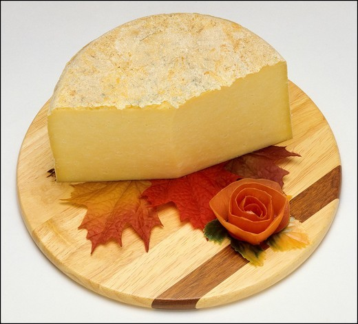 Stock Photo: 1566-702061 Cantal French cheese and wedge on wooden board