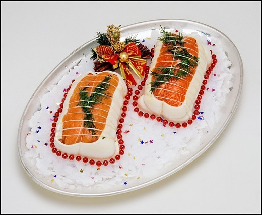 2 raw roasting joints of Salmon Trout fish on platter with ice : Stock Photo
