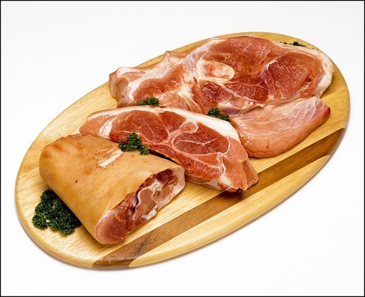 Stock Photo: 1566-702506 Raw sliced pork shoulder on wooden board