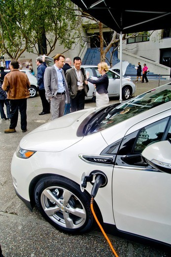 A Chevrolet Volt hybrid gas/electric car is on exhibit in Embarcadero Center in downtown San Francisco  It is the most fuel-efficient car with an internal combustion engine sold in the United States and can travel 25 to 50 miles on a lithium-ion battery w. A Chevrolet Volt hybrid gas/electric car is on exhibit in Embarcadero Center in downtown San Francisco  It is the most fuel-efficient car with an internal combustion engine sold in the United States and can travel 25 to 50 miles on a lithium-i : Stock Photo