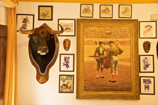 indoor decoration of restaurant La Cueva dedicated to bull fighting art Sevilla Andalucia Spain : Stock Photo