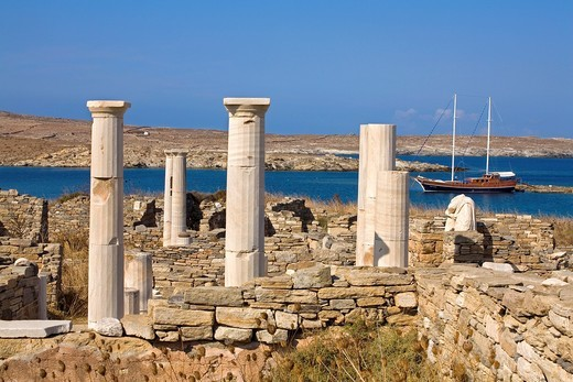 Stock Photo: 1566-704775 Jupiter temple ruins and harbour at rear  Delos, Cyclades Islands  Greece