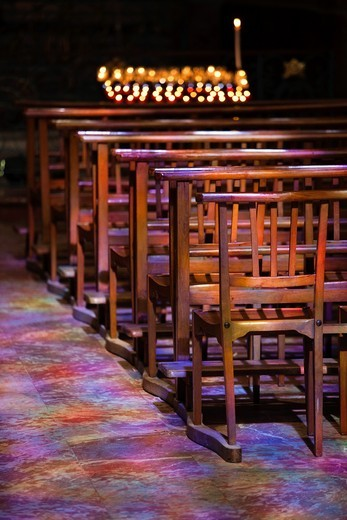 France, Languedoc-Roussillon, Pyrenees-Orientales Department, Perpignan, Cathedrale St-Jean, interior with colored light from stained-glass windows : Stock Photo