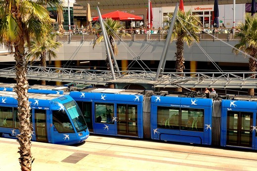 A new electric tram arrives at the tram station within the Odysseum shopping center in Montpellier, France : Stock Photo