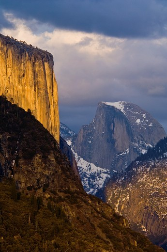 Sunset light on El Capitan and storm clouds over Half Dome and Yosemite Valley, Yosemite National Park, California : Stock Photo