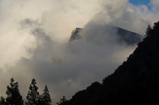 Half Dome emerges from storm clouds, Yosemite Valley, Yosemite National Park, California : Stock Photo